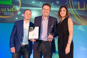 John Howie (centre), co-founder of Lintbells receives the company's award from Chris Holyland, Ecommerce Director at Pets at Home and TV presenter      Sally Nugent.
