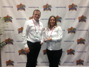 Supreme's Managing Director Chris Childs and Marketing Manager Claire Hamblion receive the award
