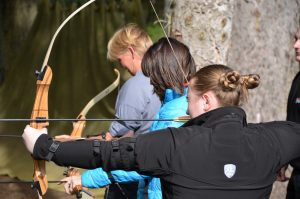 Veterinary professionals participating in archery at an XLVets National Meeting
