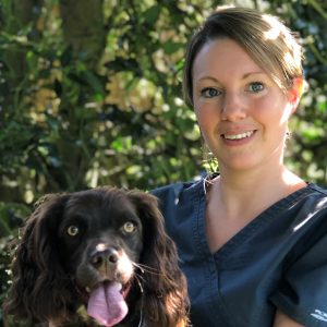 Photo shows Lyndsay Hughes holding a Spaniel