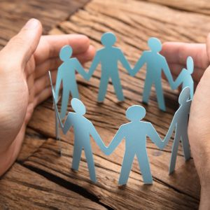 Image showing paper cutout people holding hands to represent teamwork