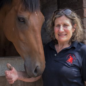 Image shows Sue Taylor with a horse